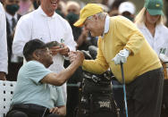 Honorary starter Lee Elder, left, shakes hands with six-time Masters champion Jack Nicklaus during the ceremonial tee shots to begin the Masters golf tournament at Augusta National Golf Club in Augusta, Ga., Thursday, April 8, 2021. (Curtis Compton/Atlanta Journal-Constitution via AP)