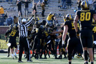 Teammates mob Missouri place kicker Harrison Mevis after he kicked a 32-yard field goal to defeat Arkansas 50-48 on the final play of an NCAA college football game Saturday, Dec. 5, 2020, in Columbia, Mo. (AP Photo/L.G. Patterson)