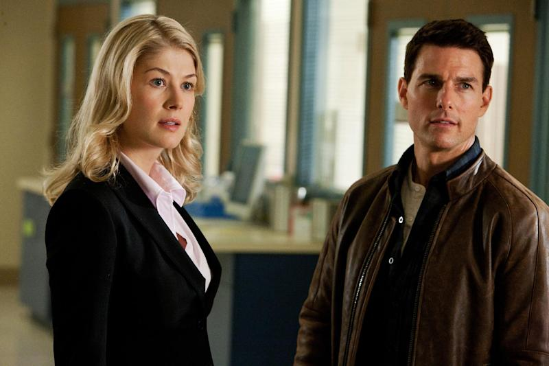 """This undated publicity photo released by Paramount Pictures shows, from left, Rosamund Pike as Helen, and Tom Cruise as Reacher, in the film, """"Jack Reacher."""" (AP Photo/Paramount Pictures, Karen Ballard)"""