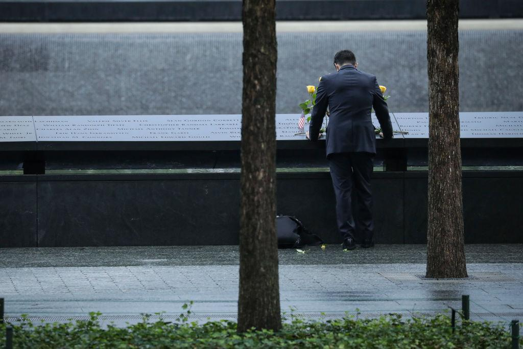 <p>NEW YORK, NY – SEPTEMBER 11: A man pauses at the north pool before the start of a commemoration ceremony for the victims of the September 11 terrorist attacks at the National September 11 Memorial,, September 11, 2018 in New York City. In New York City and throughout the United States, the country is marking the 17th anniversary of the September 11 terrorist attacks. (Photo by Drew Angerer/Getty Images) </p>