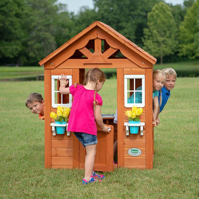 This sturdy wood playhouse is $60 off! (Photo: Walmart)