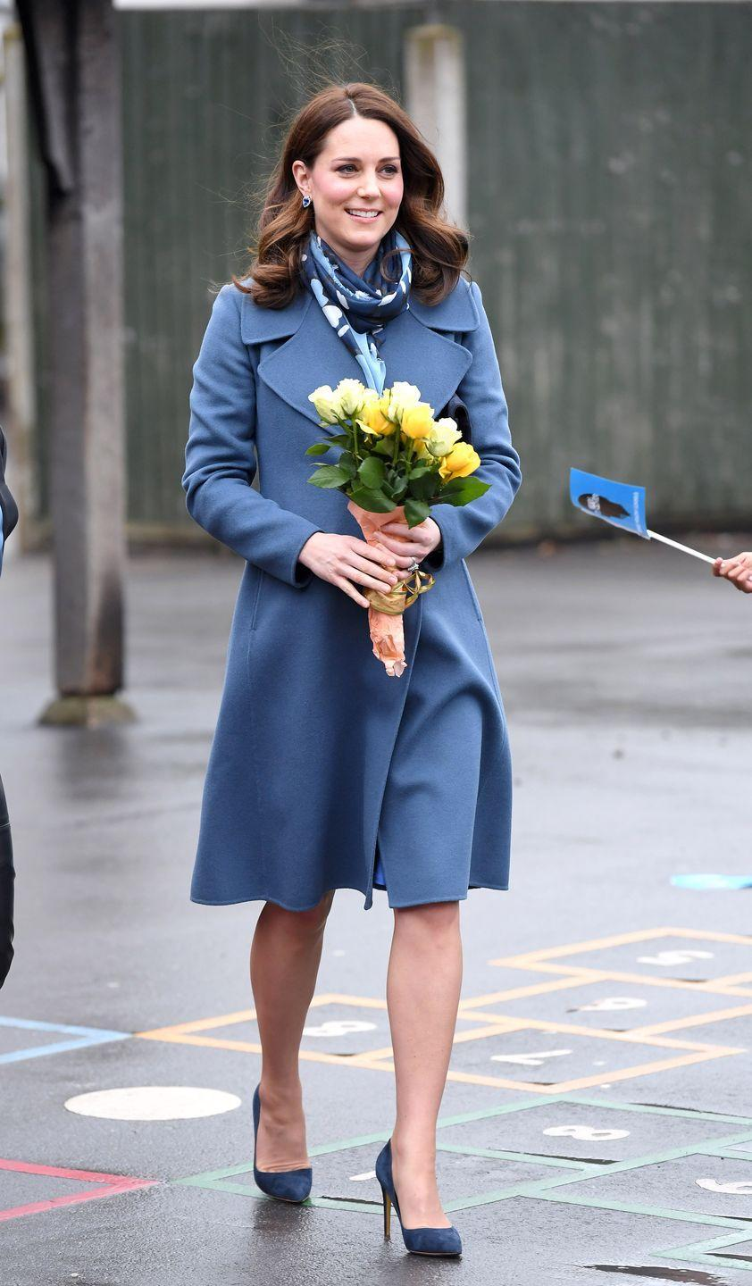 """<p>In a blue Sportmax coat (which she wore at an event <a href=""""http://www.telegraph.co.uk/news/uknews/kate-middleton/11420492/Duchess-of-Cambridge-a-dab-hand-at-pottery-skills-on-visit-to-Emma-Bridgewater-factory.html"""" rel=""""nofollow noopener"""" target=""""_blank"""" data-ylk=""""slk:in 2015"""" class=""""link rapid-noclick-resp"""">in 2015</a>), Séraphine Maternity dress, Beulah London scarf, and navy blue pumps while attending an engagement for Head Together.</p>"""