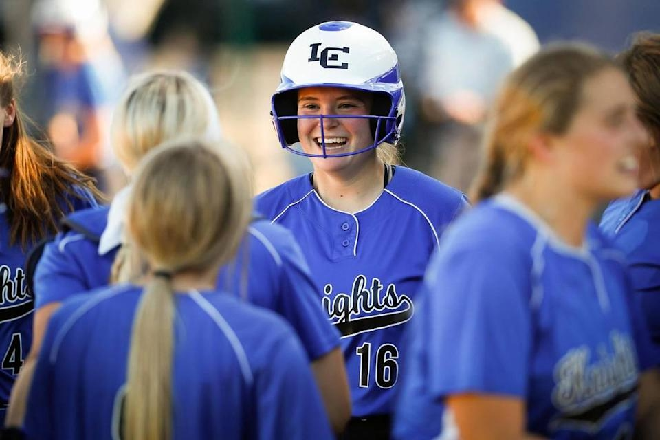 Lexington Catholic's Sara Prisinzano (16) celebrated with teammates after hitting a home run against Lafayette on Thursday. The Knights won 3-0.