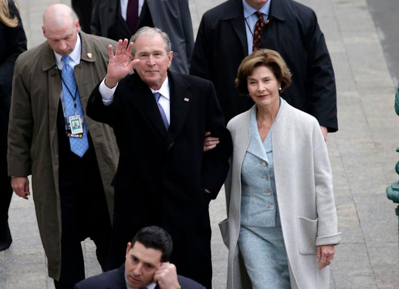Former President George W. Bush and his wife, Laura Bush, arrive at the Capitol for the inauguration of Donald Trump last year.