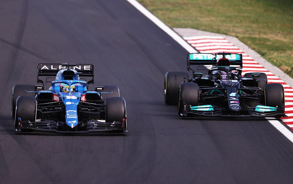 BUDAPEST, HUNGARY - AUGUST 01: Fernando Alonso of Spain driving the (14) Alpine A521 Renault defends from Lewis Hamilton of Great Britain driving the (44) Mercedes AMG Petronas F1 Team Mercedes W12 during the F1 Grand Prix of Hungary at Hungaroring on August 01, 2021 in Budapest, Hungary. (Photo by Lars Baron/Getty Images)