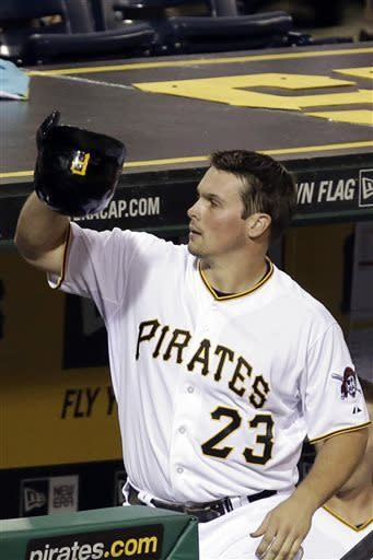 Pittsburgh Pirates' Travis Snider (23) takes a curtain call on the dugout steps after hitting a grand slam off Chicago Cubs relief pitcher Shawn Camp during the sixth inning of a baseball game in Pittsburgh, Tuesday, May 21, 2013. (AP Photo/Gene J. Puskar)