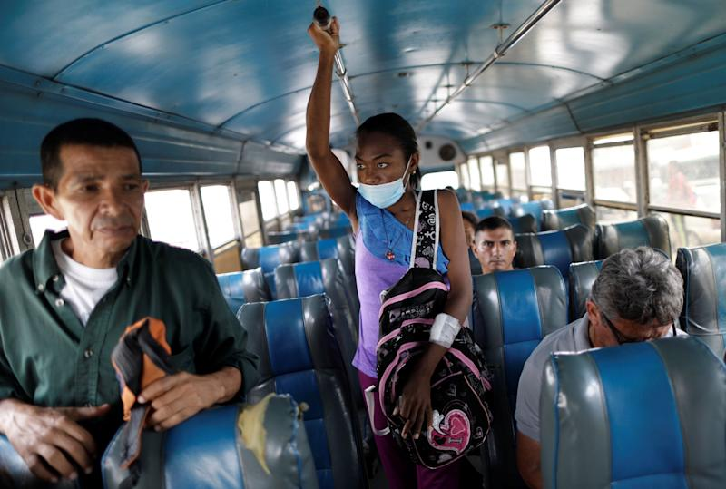 "Aidalis Guanipa, 25, a kidney disease patient, travels by bus after a dialysis session at a dialysis center in Maracaibo, Venezuela. ""I should have been born rich to be able to buy myself a new kidney,"" said Guanipa. They get by on her 83-year-old grandmother's pension and from sales of homemade sweets. (Photo: Ueslei Marcelino/Reuters)"