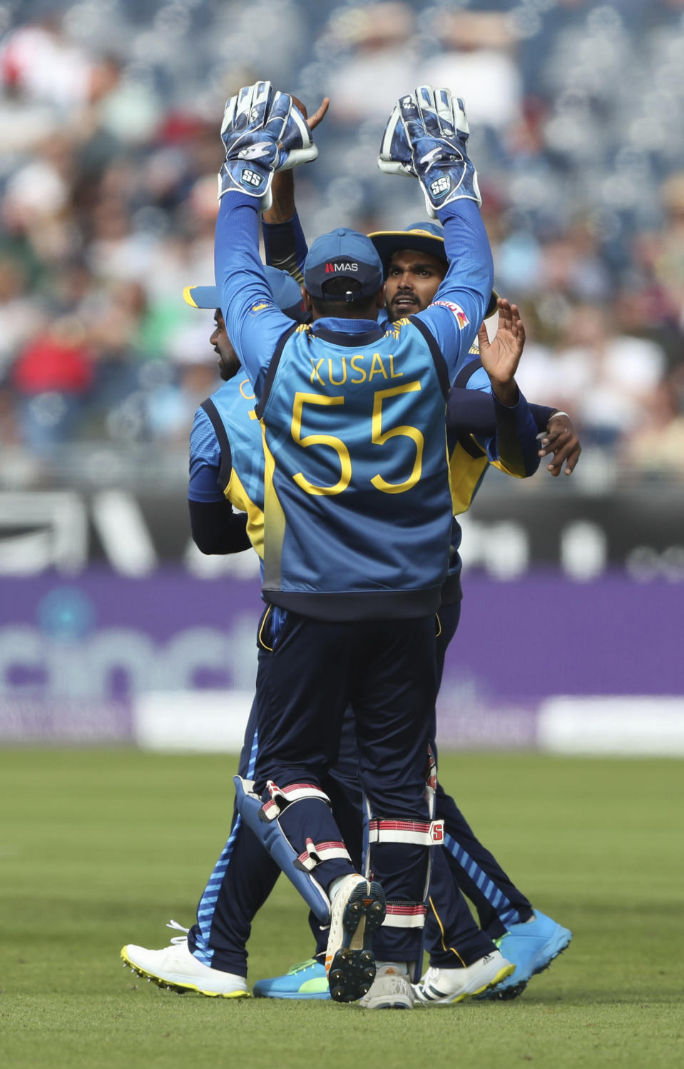 Sri Lankan players celebrate the dismissal of England's Sam Billings during the first one day international cricket match between England and Sri Lanka, in Chester-le-Street, England, Tuesday, June 29, 2021. (AP Photo/Scott Heppell)