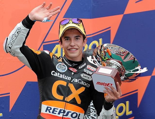 Team CatalunyaCaixa Repsol's Spanish Marc Marquez celebrates on the podium after the Moto2 race of the Catalunya Moto GP Grand Prix at the Catalunya racetrack in Montmelo, near Barcelona, on June 3, 2012. Speed Master's Italian Andrea Iannone won the race ahead of Interwetten-Paddock's Swiss Thomas Luthi and Team CatalunyaCaixa Repsol 's Spanish Marc Marquez.v AFP PHOTO / LLUIS GENELLUIS GENE/AFP/GettyImages