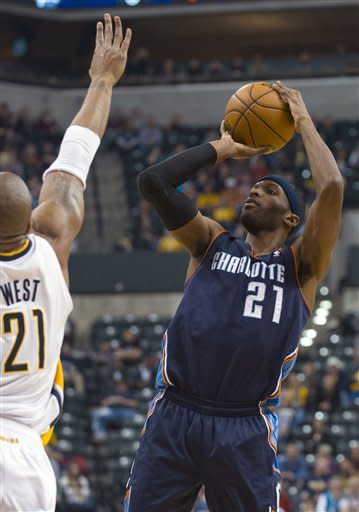 Charlotte Bobcats' Hakim Warrick (21) shoots against Indiana Pacers' David West (21) during the first half of an NBA basketball game in Indianapolis, Saturday, Jan. 12, 2013. (AP Photo/Doug McSchooler)