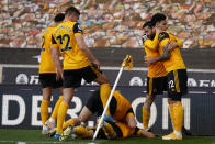Wolverhampton Wanderers players celebrate after Morgan Gibbs-White scored his side's second goal during the English Premier League soccer match between Wolverhampton Wanderers and Brighton & Hove Albion at the Molineux Stadium in Wolverhampton, England, Sunday, May 9, 2021. (Tim Keeton/Pool via AP)