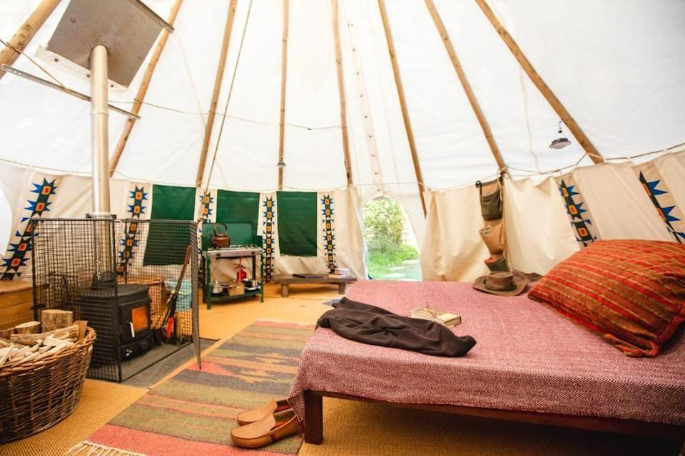 """<p>This eco-friendly glamping site is set within 20 acres of land with stunning views over Carmarthen and Cardigan Bay. The entire luxury campsite is run by alternative energy - wind and solar, with electricity coming from solar, hydro and wind power and the tipis heated by a cast-iron woodburner. At <a href=""""https://go.redirectingat.com?id=127X1599956&url=https%3A%2F%2Fwww.booking.com%2Fhotel%2Fgb%2Flarkhill-tipis-and-yurts.en-gb.html%3Faid%3D2070929%26label%3Dsustainable-hotels&sref=https%3A%2F%2Fwww.redonline.co.uk%2Ftravel%2Fg36889465%2Fsustainable-hotels%2F"""" rel=""""nofollow noopener"""" target=""""_blank"""" data-ylk=""""slk:Larkhill Tipis and Yurts"""" class=""""link rapid-noclick-resp"""">Larkhill Tipis and Yurts</a>, you can wander through the beautiful countryside or take a canoe out on the River Teifi before relaxing at the campfire to end the day.</p><p><a class=""""link rapid-noclick-resp"""" href=""""https://go.redirectingat.com?id=127X1599956&url=https%3A%2F%2Fwww.booking.com%2Fhotel%2Fgb%2Flarkhill-tipis-and-yurts.en-gb.html%3Faid%3D2070929%26label%3Dsustainable-hotels&sref=https%3A%2F%2Fwww.redonline.co.uk%2Ftravel%2Fg36889465%2Fsustainable-hotels%2F"""" rel=""""nofollow noopener"""" target=""""_blank"""" data-ylk=""""slk:CHECK AVAILABILITY"""">CHECK AVAILABILITY</a></p>"""
