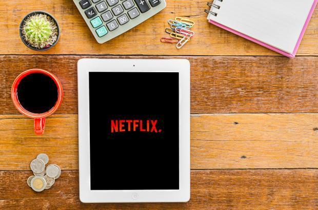 Netflix surges on user gains, strong profits