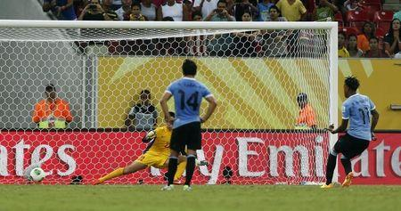 Uruguay's Abel Hernandez (R) scores a penalty goal for his fourth, and his team's sixth goal against Tahiti during their Confederations Cup Group B soccer match at the Arena Pernambuco in Recife June 23, 2013. REUTERS/Ivan Alvarado