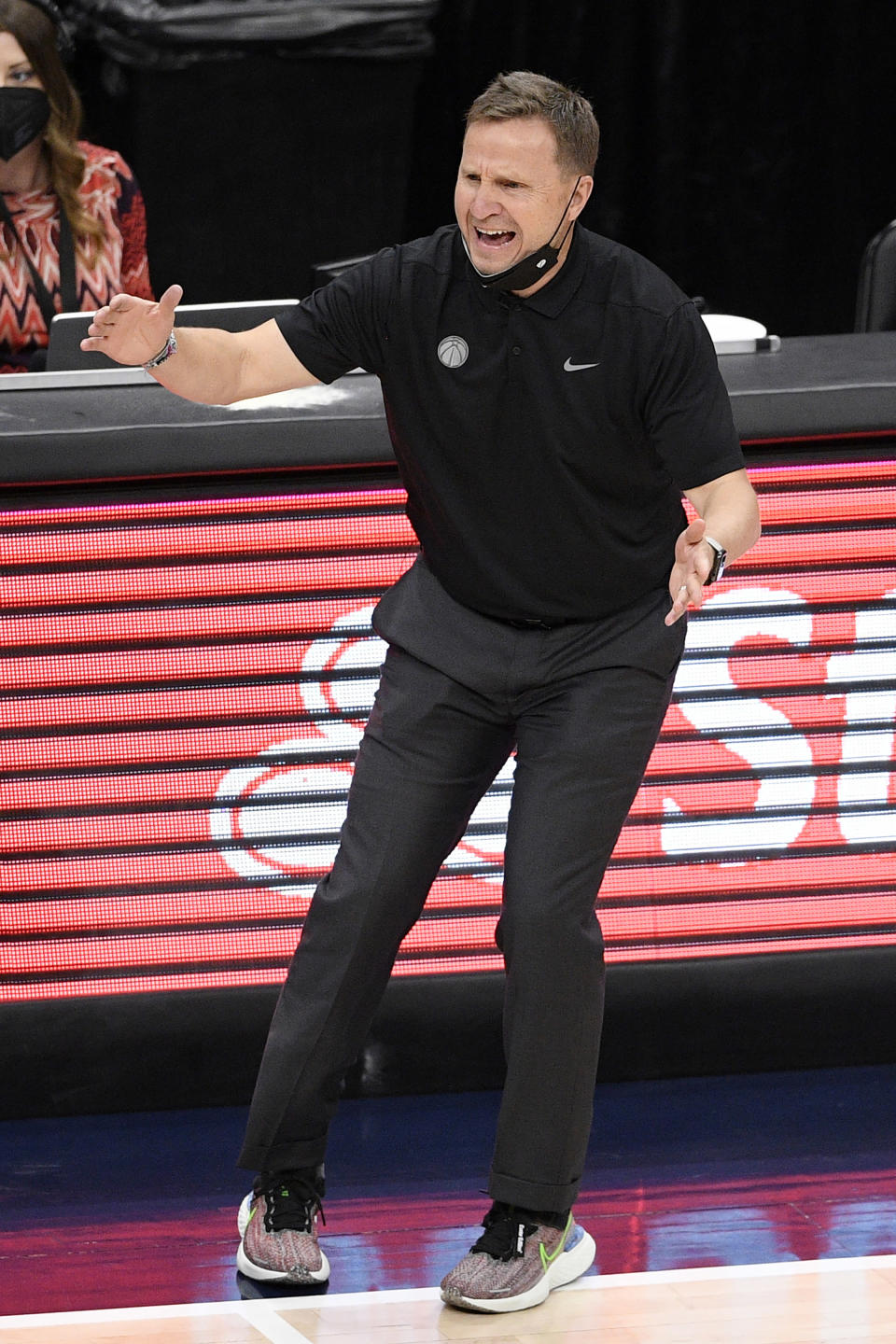 FILE - Washington Wizards coach Scott Brooks reacts during the first half of the team's NBA basketball Eastern Conference play-in game against the Indiana Pacers in Washington, in this Thursday, May 20, 2021, file photo. Scott Brooks is out as coach of the Washington Wizards, said a person with knowledge of the situation. The person spoke to The Associated Press Wednesday, June 16, 2021, on condition of anonymity because the team hadn't publicly announced the decision. (AP Photo/Nick Wass, File)