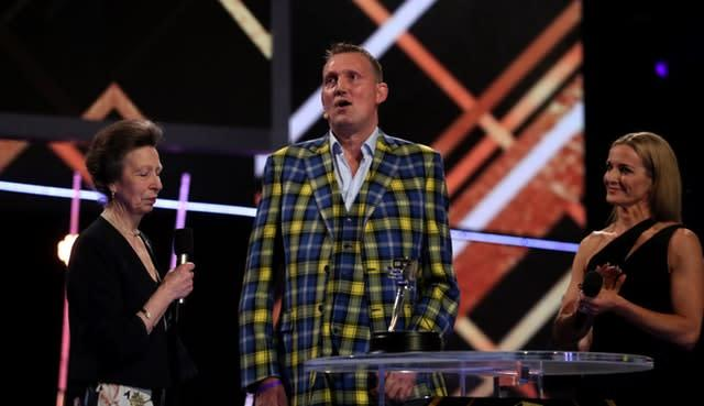 Doddie Weir (centre) received the Helen Rollason Award from the Princess Royal during the BBC Sports Personality of the Year in Aberdeen on Sunday (Jane Barlow/PA)