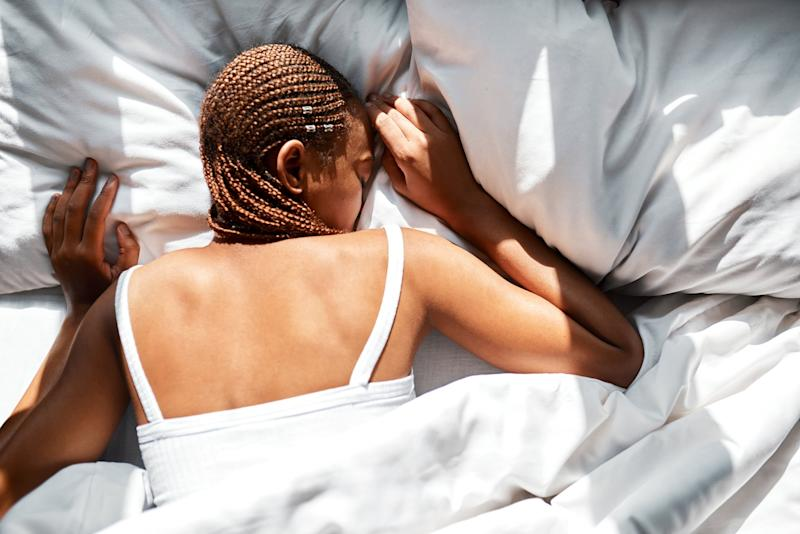 Shot of a woman sleeping on her front