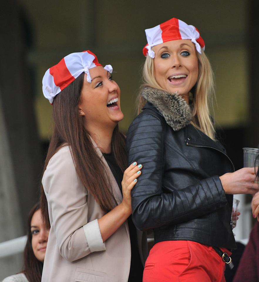 Two England fans wait for the rain to stop during the Natwest International Twenty20 match at the Kia Oval, London.
