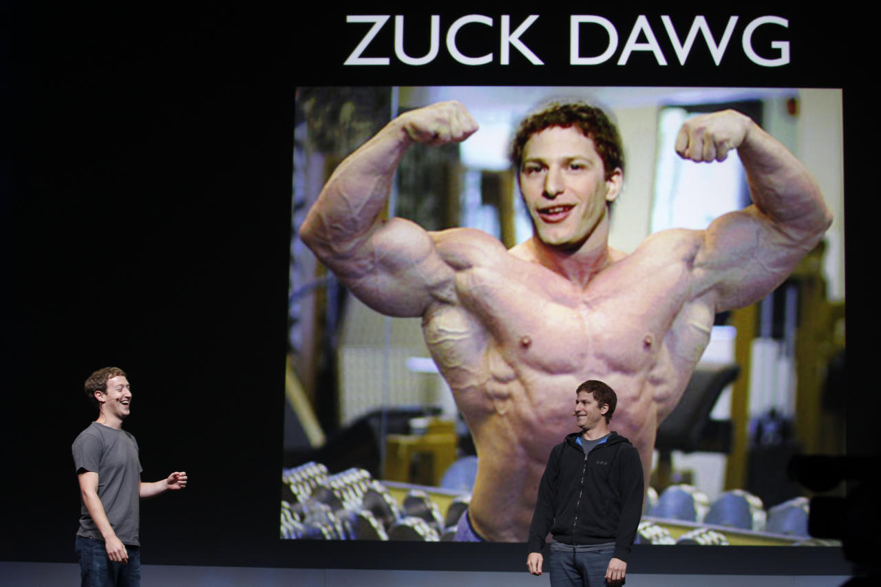 Facebook CEO Mark Zuckerberg, left, smiles at comedian Adam Samberg, right, of Saturday Night Live, during the f/8 conference in San Francisco, Thursday, Sept. 22, 2011. (AP Photo/Paul Sakuma)
