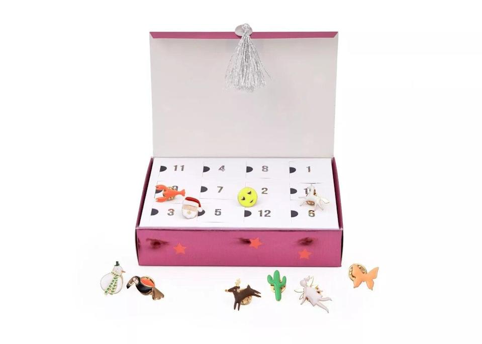 "<h3>Meri Meri Enamel Pin Advent Calendar<br></h3><br>Whimsical enamel pins are an easy way to trick out any denim jacket or backpack. This adorable 12-day advent calendar features not only festive designs (mini Santa and reindeer), but pins you'll want to sport year-round, too: Butterfly, a cactus, and....a lobster?<br><br><strong>Meri Meri</strong> Enamel Pin Advent Calendar, $, available at <a href=""https://go.skimresources.com/?id=30283X879131&url=https%3A%2F%2Fgoto.target.com%2F6axvK"" rel=""nofollow noopener"" target=""_blank"" data-ylk=""slk:Target"" class=""link rapid-noclick-resp"">Target</a>"