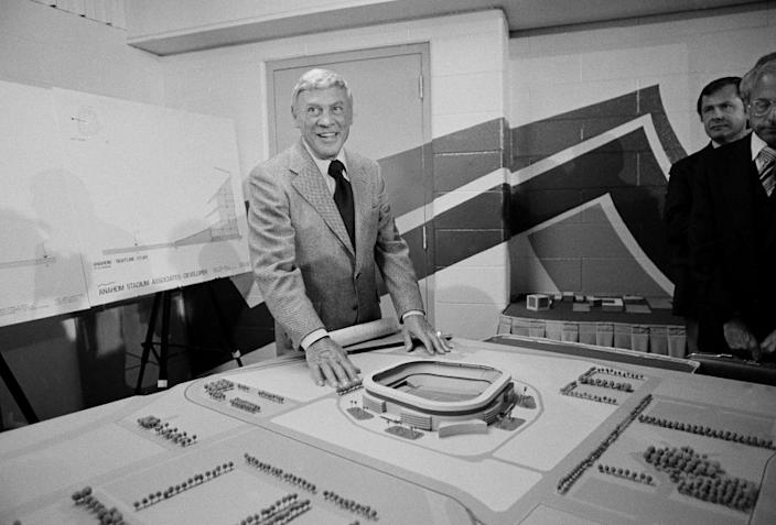 "Former Los Angeles Rams owner Carroll Rosenbloom poses with a model of Anaheim Stadium in July 1978. <span class=""copyright"">(Associated Press)</span>"
