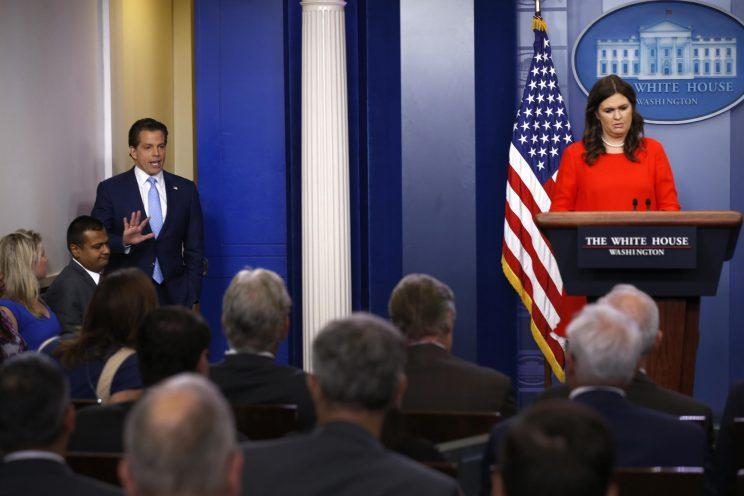 Sarah Huckabee Sanders, flanked by new White House communications director Anthony Scaramucci, holds the daily briefing at the White House in Washington.