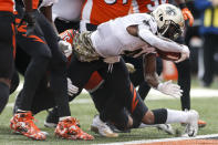 New Orleans Saints running back Alvin Kamara dives in for a touchdown in the first half of an NFL football game against the Cincinnati Bengals, Sunday, Nov. 11, 2018, in Cincinnati. (AP Photo/Gary Landers)