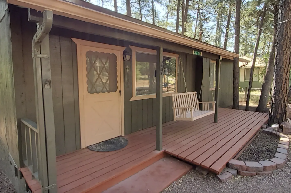 """<h2>Sedona, Arizona</h2><br><strong>Location:</strong> Pine, AZ<br><strong>Sleeps:</strong> 6<br><strong>Price Per Night:</strong> <a href=""""https://airbnb.pvxt.net/e4nVyz"""" rel=""""nofollow noopener"""" target=""""_blank"""" data-ylk=""""slk:$147"""" class=""""link rapid-noclick-resp"""">$147</a><br><br>""""An inviting porch swing welcomes you to this two-bedroom cabin, perfect for a summer retreat. A wood-burning fireplace anchors the living room, which opens into a delightful eat-in kitchen with white cabinetry and laminate floor. Both bedrooms are a nice size with roomy closets. A full-size washer and dryer are located in the hall['s] full bathroom. Private covered rear deck and spacious wooded backyard are perfect for relaxing.""""<br><br><h3>Book <a href=""""https://airbnb.pvxt.net/e4nVyz"""" rel=""""nofollow noopener"""" target=""""_blank"""" data-ylk=""""slk:The Elk Run Lodge"""" class=""""link rapid-noclick-resp"""">The Elk Run Lodge</a></h3>"""