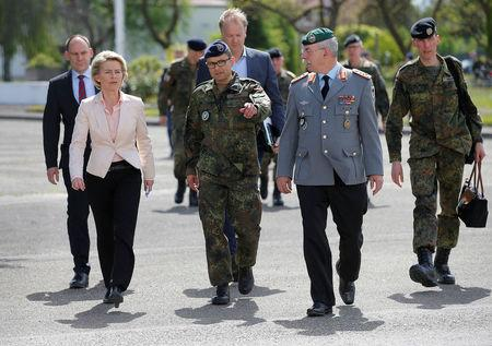 "German Defence Minister Ursula von per Leyen (L) walks with the commander of the German 291st fighter squadron, Marc-Ulrich Cropp (C) and General Joerg Vollmer, general inspector of the German land army, during her visit at  the 291st fighter squadron based at the ""Quartier Leclerc"", a military facility for French and German military units in Illkirch-Graffenstaden near Strasbourg, France May 3, 2017. REUTERS/Vincent Kessler"