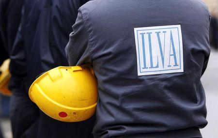 A worker from ILVA steel plant protests on the west highway in Genoa
