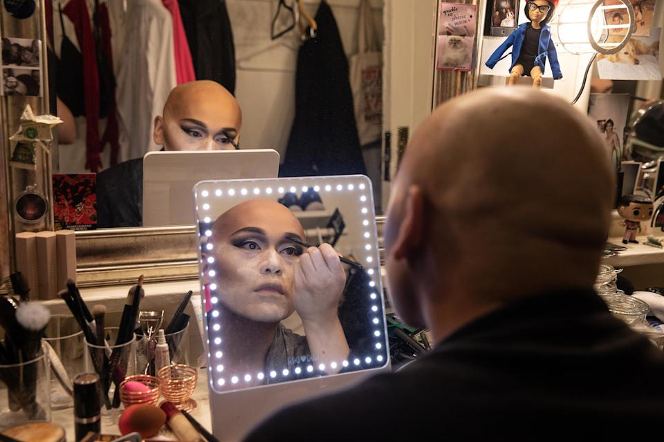 Actor Jeigh Madjus, who plays 'Babydoll,' doing his makeup in the dressing room backstage before rehearsal on on Sept. 21, 2021. Madjus says that sometimes his makeup can take up to two hours to complete.