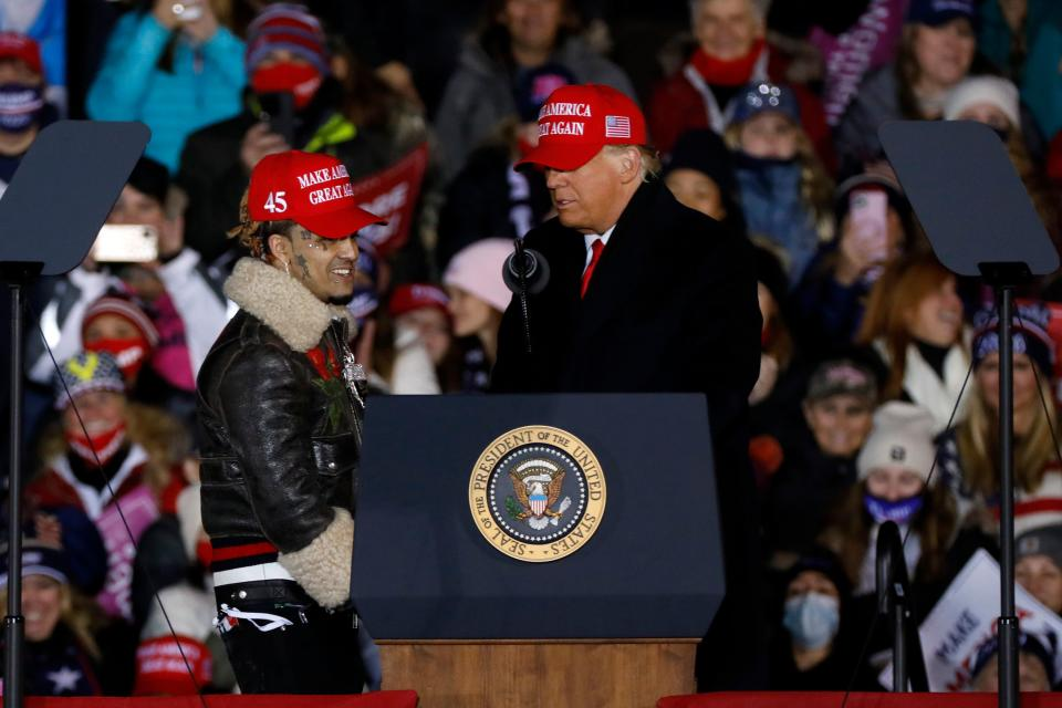 US President Donald Trump invites rapper Lil Pump on stage during his final Make America Great Again rally of the 2020 US Presidential campaign at Gerald R. Ford International Airport on November 2, 2020, in Grand Rapids, Michigan. (Photo by JEFF KOWALSKY / AFP) (Photo by JEFF KOWALSKY/AFP via Getty Images)