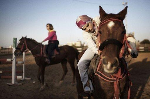 Palestinian women ride horses at the Al-Faisal riding centre in Gaza City on January 10, 2012. Horse riding has become a popular hobby in the Gaza Strip but local Palestinians face constant hurdles -- from a conservative society to Israel's blockade on the territory -- to practise the sport on their home turf