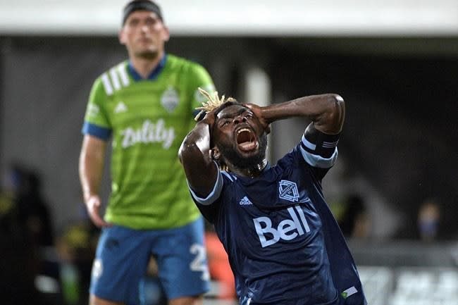 Morris, Lodeiro lead Sounders past rival Whitecaps 3-0