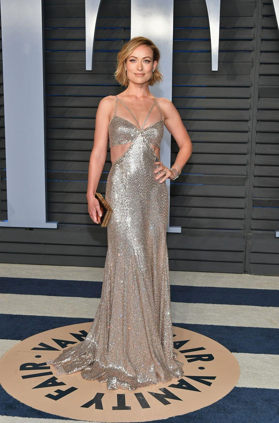 <p>Wilde wore a dazzling Roberto Cavalli Couture gold dress complete with a Time's Up pin for the celebrity-filled event and dare we say, outshone the rest of the guests. </p>