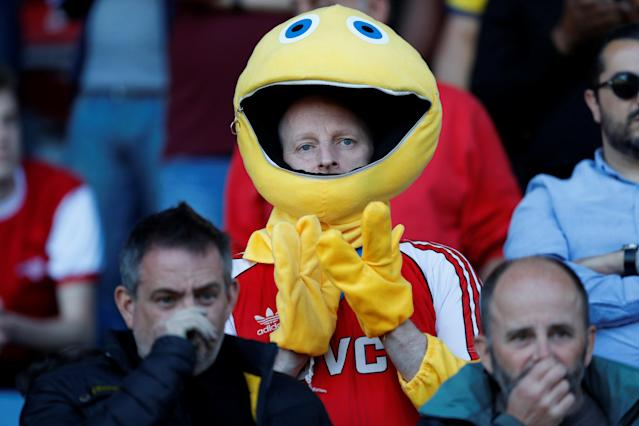 "Soccer Football - Premier League - Huddersfield Town vs Arsenal - John Smith's Stadium, Huddersfield, Britain - May 13, 2018 Arsenal fan in fancy dress Action Images via Reuters/Andrew Boyers EDITORIAL USE ONLY. No use with unauthorized audio, video, data, fixture lists, club/league logos or ""live"" services. Online in-match use limited to 75 images, no video emulation. No use in betting, games or single club/league/player publications. Please contact your account representative for further details."