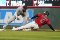 Detroit Tigers second baseman Willi Castro, left, tags out Minnesota Twins' Mitch Garver at second base on a steal attempt in the eighth inning of a baseball game, Monday, July 26, 2021, in Minneapolis. The Twins won 6-5 in 10 innings. (AP Photo/Jim Mone)