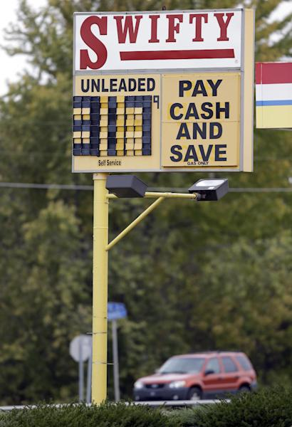 A Swifty gas station in Kokomo, Ind., advertises a discount for cast as gas sold for $3.17 in Kokomo, Ind., Thursday, Oct. 24, 2013. Local gasoline prices are swinging up and down ever more drastically, a result of a national fuel system that is operating with a shrinking margin for error. (AP Photo/Michael Conroy)