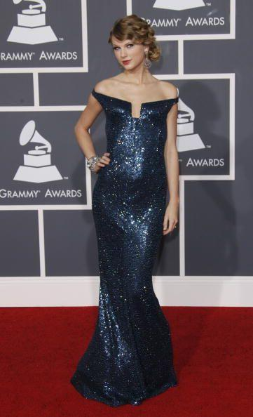 <p>This was a big night for Tay as she won four awards, just a few months after that incident with Kanye West at the VMAs made international headlines.</p><p>To collect her awards, she wore a bardot-style midnight blue encrusted gown.</p>