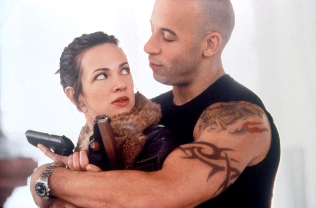 "Vin Diesel's title character in the 2002 movie ""xXx"" also met his woman on the job -- she was the girlfriend of the bad guy leading a group he was recruited to infiltrate. A former spy herself, Yelena (Asia Argento) was a worthy partner for our Xander Cage. The cast is reportedly in pre-production on a sequel. ©Columbia Pictures/Courtesy Everett Collection"