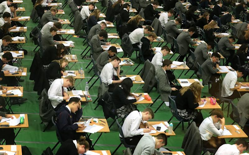 Students taking exam in a hall