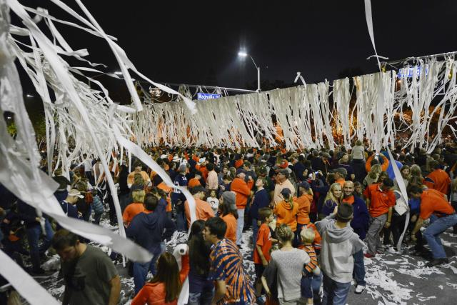 Auburn fans celebrate at Toomer's Corner after beating Georgia 43-38 in their NCAA college football game on Saturday, Nov. 16, 2013 in Auburn, Ala.(AP Photo/Todd J. Van Emst)