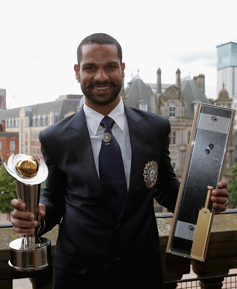 BIRMINGHAM, ENGLAND - JUNE 24: 'Player of the Tournament' Shikhar Dhawan poses with his awards during a photocall for the winners of the ICC Champions Trophy on June 24, 2013 in Birmingham, England.  (Photo by Harry Engels-ICC/ICC via Getty Images)