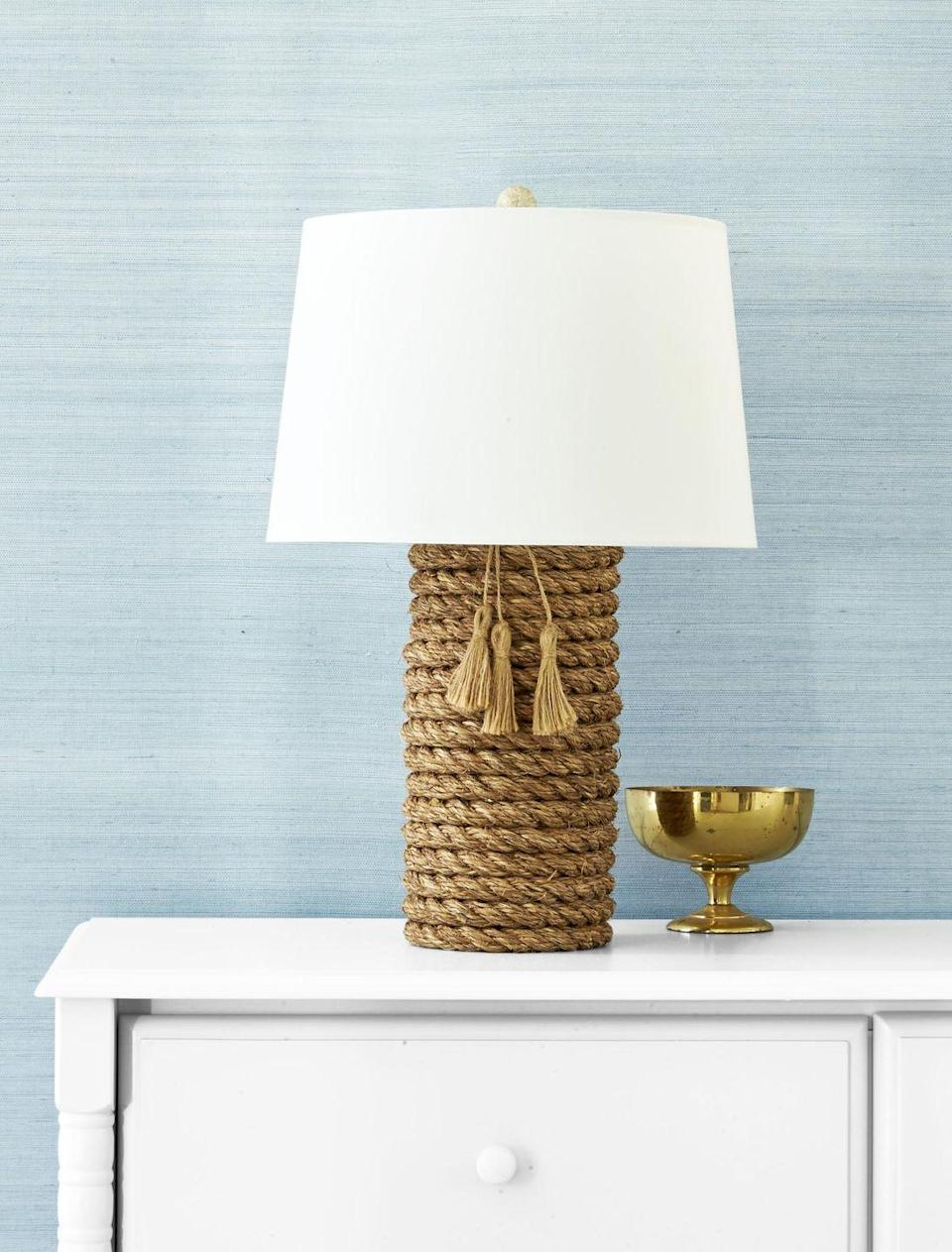 """<p>Have a lamp you are just tired of looking at? Try wrapping it with rope to give it a whole new, modern vibe.<strong><br></strong></p><p><strong>To make:</strong> Wrap a cylindrical lamp base with 3/4-inch-thick manila<br>rope, holding it in place with hot-glue. For added flair, hang burlap tassels <a href=""""https://www.amazon.com/Tegg-Natural-Embellishing-Wedding-Decoration/dp/B08GCB6Q66/ref=sr_1_2"""" rel=""""nofollow noopener"""" target=""""_blank"""" data-ylk=""""slk:($9; amazon.com"""" class=""""link rapid-noclick-resp"""">($9; <em>amazon.com</em></a>) from the lamp's neck.<br></p>"""