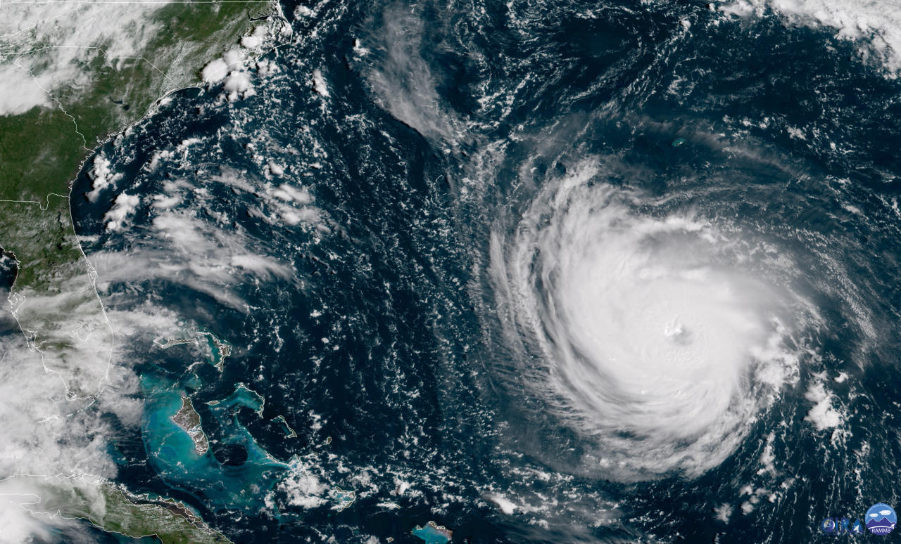 <p>This GOES East satellite image taken Tuesday, Sept. 11, 2018, at 10:30 a.m. EDT, and provided by NOAA shows Hurricane Florence in the Atlantic Ocean as it threatens the U.S. East Coast, including Florida, Georgia, South and North Carolina. (Photo: NOAA via AP) </p>