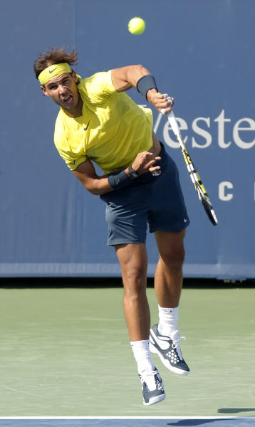 Rafael Nadal, of Spain, serves Tomas Berdych, of the Czech Republic, during a semifinal at the Western & Southern Open tennis tournament, Saturday, Aug. 17, 2013, in Mason, Ohio. (AP Photo/David Kohl)