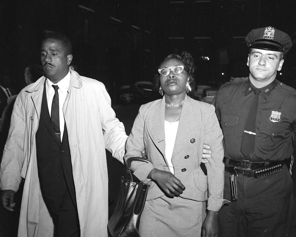 Izola Ware Curry is arrested for stabbing Martin Luther King Jr. with a letter opener at a department store in Harlem while he was there for a book signing, on Sept. 20, 1958. (Photo: Pat Candido/NY Daily News via Getty Images)