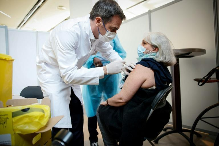 """French Health Minister Olivier Veran, seen here administering a Covid-19 vaccine dose, described the attempt to smear the Pfizer/BioNTech vaccine as """"pathetic"""""""