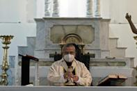 Mexican Archbishop Francisco Moreno Barron wears a face mask as he celebrates Easter Mass at the empty cathedral in Tijuana (AFP Photo/Guillermo Arias)