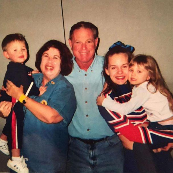 PHOTO: Buddy Baker held by mother, Adrian Baker, and pictured with family. (Courtesy Alyssa Baker)